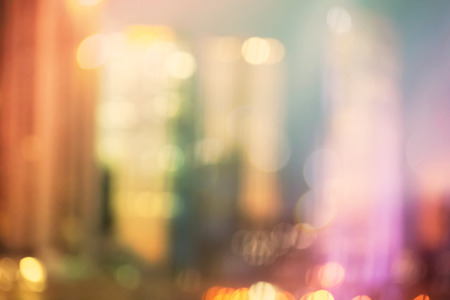 urban scenes: Blurred colorful urban building background scene with bokeh lights