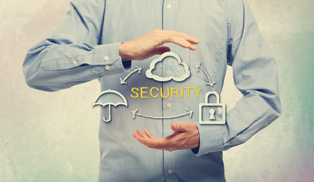 Security Concept Design Using Umbrella, Cloud and Lock, with Arrows, Between Human Hands on an Light Blue Background photo