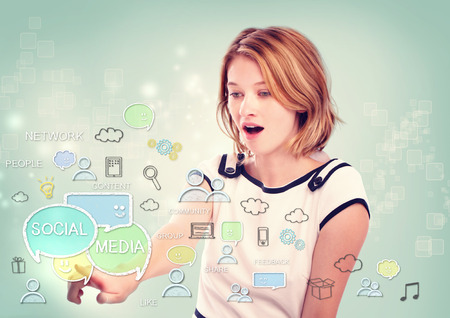 Young woman pointing to social media concepts on light blue background photo