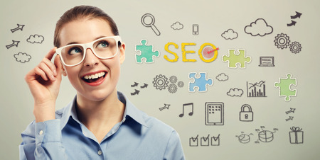 woman on phone: Young business woman wearing big white eye glasses with SEO concepts