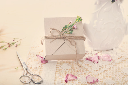 hand crafted: Hand crafted present box with flower petals Stock Photo