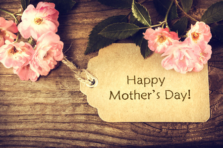 Mothers day card with roses on wood background Stock Photo