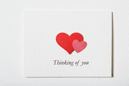 thinking of you: Thinking of You white message card with hand made hearts Stock Photo