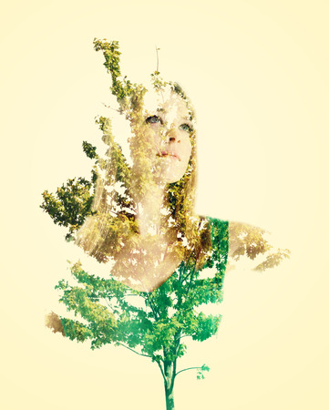 the double: Double exposure portrait of young woman with abstract leaves Stock Photo