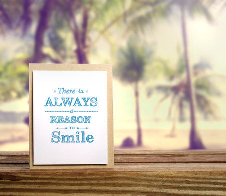 summer: There is always a reason to smile inspirational message card on tropical beach background Stock Photo