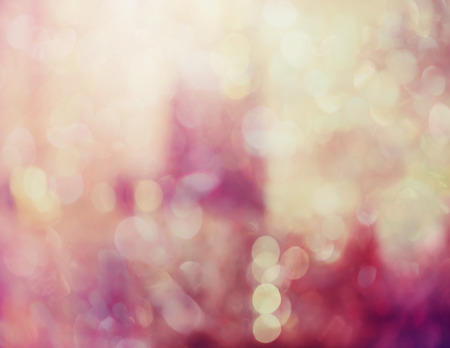 Abstract ethereal soft pink background with sparkling bokeh of defocused lights in a dreamy background