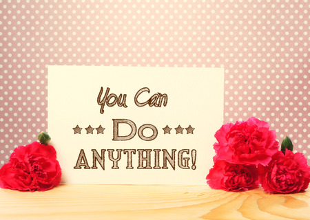 anything: You Can Do Anything Message Card with Carnation Flowers on Top of a Wooden Table