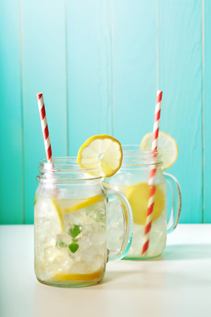 red straw: Homemade lemonade in mason jars with big red striped straws