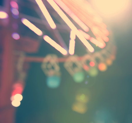 Blurred background giant ferris wheel at night Stock Photo