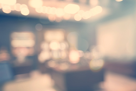 Blurred bokeh interior background in muted colors