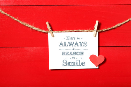clothespins: There is always a reason to smile message card hanging with clothespins