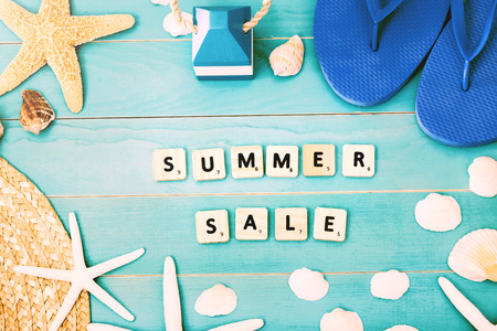 Wood Blocks on Light Blue Table with Sea Shells, Starfish, Beach Hat and Slippers for Summer Sale Concept 版權商用圖片 - 43316943