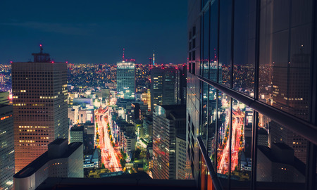 aerial view: Aerial view of a massive highway intersection at night in Shinjuku, Tokyo, Japan from a skyscraper Stock Photo