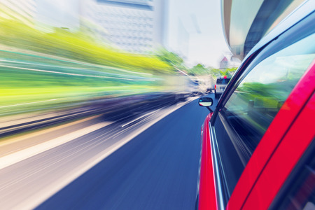 cars on the road: Motion blurred drive through the city via taxi cab Stock Photo