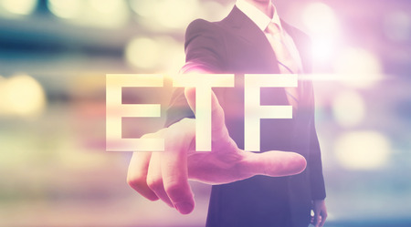 traded: Businessman pointing at ETF (Exchange Traded Funds) on blurred city background Stock Photo