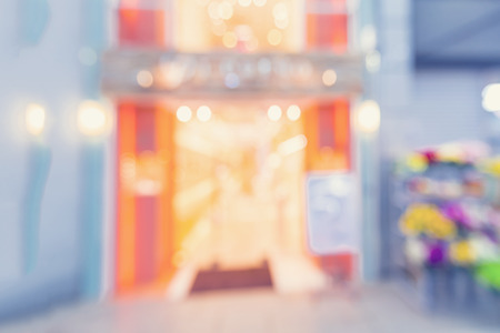 store front: Defocused shopping mall interior store front