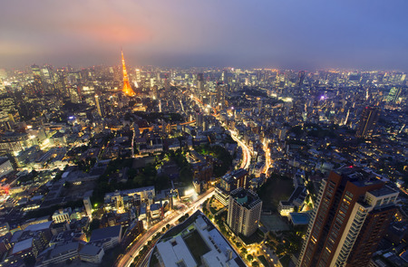 night traffic: Aerial view of Tokyo with a view of Tokyo Tower in the background at night