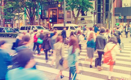 omotesando: Motion blurred people crossing the street outside Tokyu Plaza, Omohara, Tokyo, Japan
