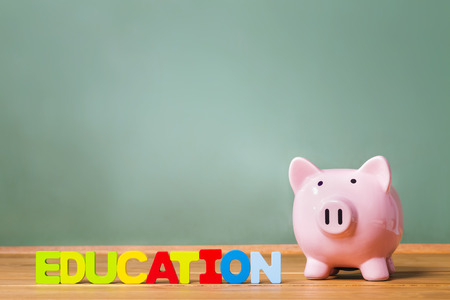 college fund savings: Education theme with piggy bank and green chalkboard background