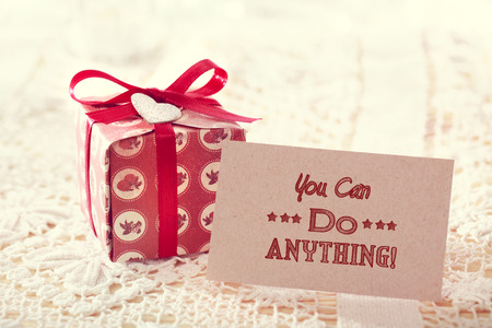 giftbox: You can do anything! Inspirational message card with cute giftbox