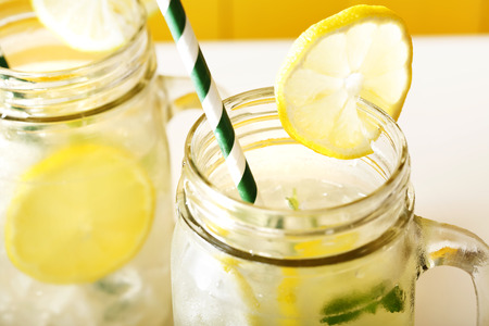 cocktails: Homemade lemonade in mason jars with big green paper straw