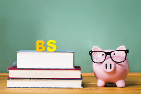 college fund savings: Bachelor of Science degree theme with textbooks and piggy bank and green chalkboard