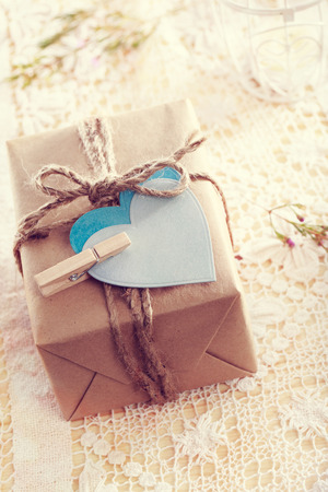 heart gift box: Heart-shaped tags and hand crafted present box Stock Photo