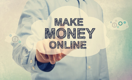money online: Young man in blue shirt pointing at Make Money Online text Stock Photo