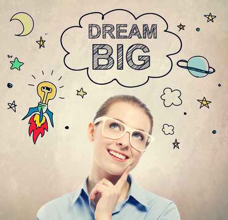Dream Big idea sketch with young business woman wearing white eyeglasses Stock Photo