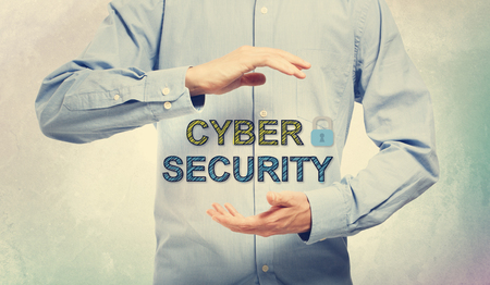 filtered: Young man in blue shirt holding Cyber Security concept