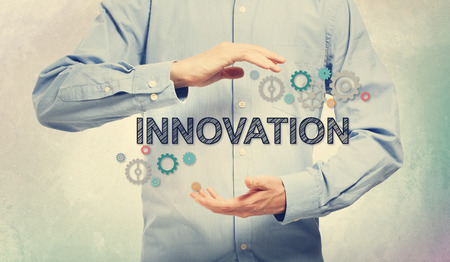 blue shirt: Young man in blue shirt holding Innovation concept Stock Photo