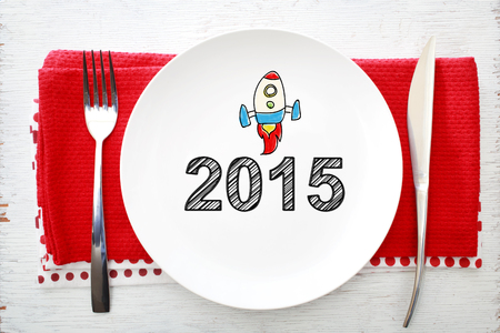 napkins: 2015 concept on white plate with fork and knife on red napkins Stock Photo