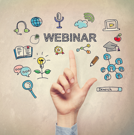 Hand pointing to Webinar concept on light brown wall background