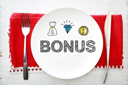 napkins: Bonus concept on white plate with fork and knife on red napkins Stock Photo
