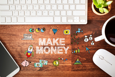 overhead view: Make Money concept with workstation on a wooden desk
