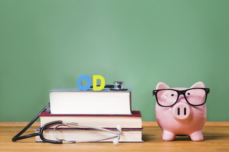 doctor of optometry: Doctor of Optometry OD theme with pink piggy bank with chalkboard  Stock Photo