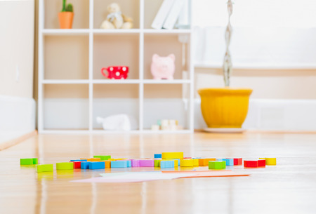baby toys: Childrens toy wood blocks inside a home Stock Photo