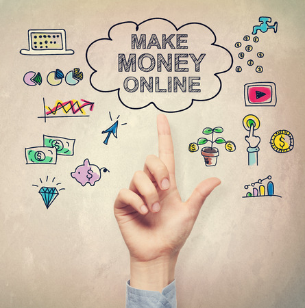 money online: Hand pointing at Make Money Online concept on light brown wall
