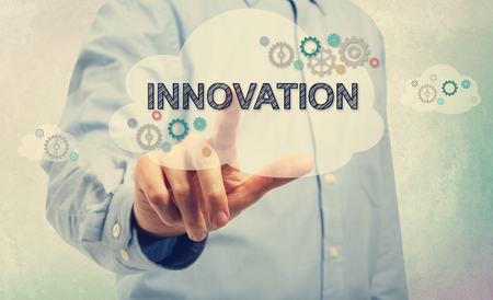 cloud technology: Young man in blue shirt pointing at Innovation
