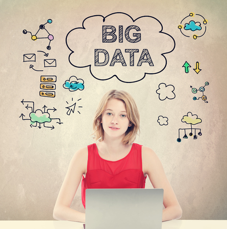 metadata: Big Data concept with young woman working on a laptop