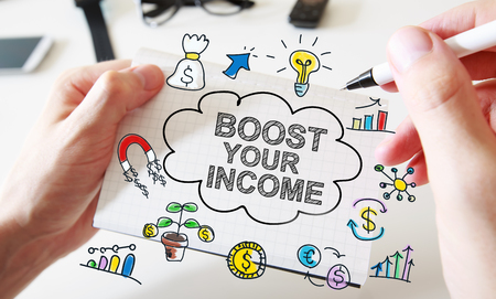 Mans hand drawing Boost Your Income concept on white notebook