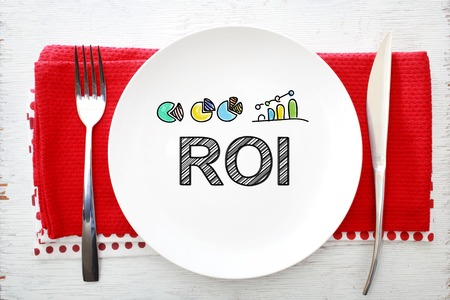 napkins: ROI concept on white plate with fork and knife on red napkins
