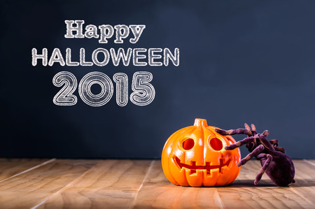 wood spider: Happy Halloween 2015 message with pumpkin and spider on black