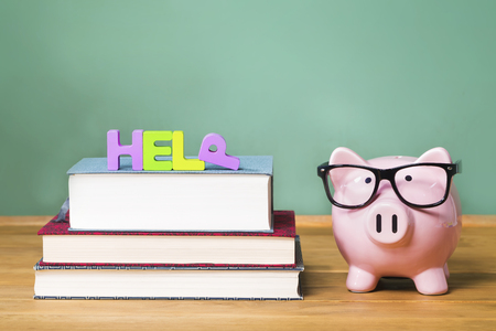 piggy: Help theme with pink piggy bank with chalkboard Stock Photo