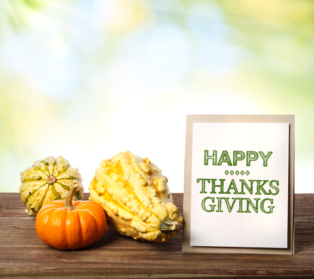 Happy Thanksgiving message card with fall squashes