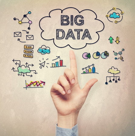 hand pointing: Hand pointing to Big Data concept on light brown wall  Stock Photo
