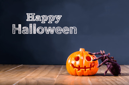 halloween message: Happy Halloween message with pumpkin and spider on black background Stock Photo