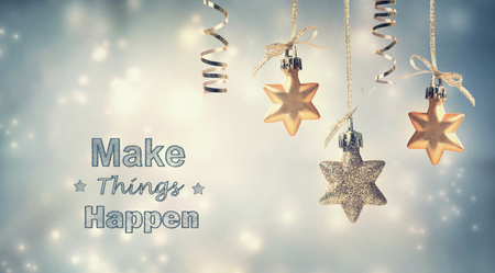 silver star: Make Things Happen this holiday season with star ornaments Stock Photo