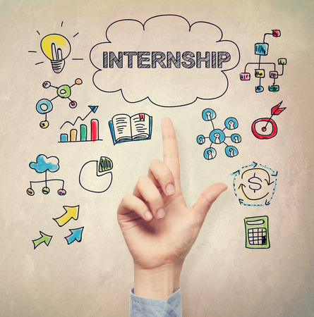 hand pointing: Hand pointing to Internship concept on light brown wall background