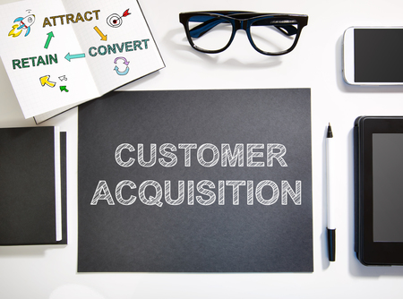 acquisition: Customer Acquisition concept top view with black and white workstation